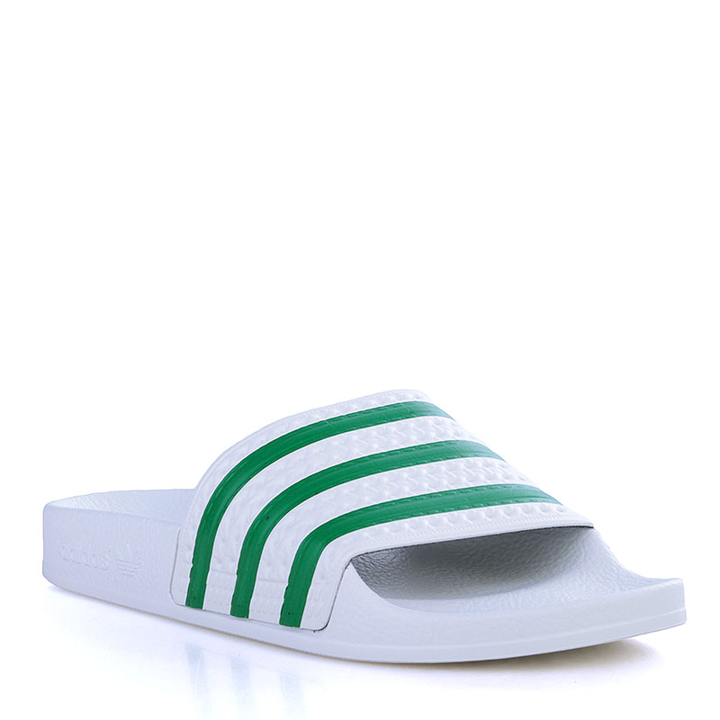 Сланцы adidas Originals AdiletteСланцы, балетки<br>Синтетика, резина<br><br>Цвет: Белый, зелёный<br>Размеры UK: 4<br>Пол: Мужской