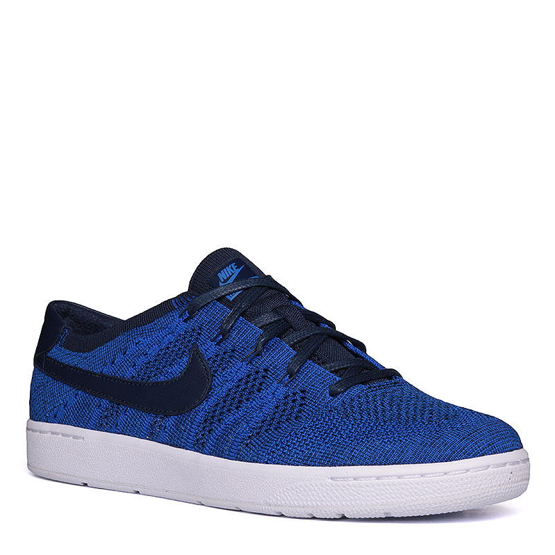 Кроссовки Nike Sportswear Tennis Classic Ultra FlyknitКроссовки lifestyle<br>Кожа, текстиль, резина<br><br>Цвет: Cиний, белый<br>Размеры US: 10;10.5;11<br>Пол: Мужской