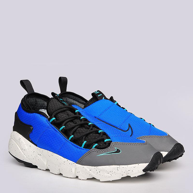 Кроссовки Nike Sportswear Air Footscape NMКроссовки lifestyle<br>Текстиль, синтетика, резина<br><br>Цвет: Синий, черный, серый<br>Размеры US: 9<br>Пол: Мужской