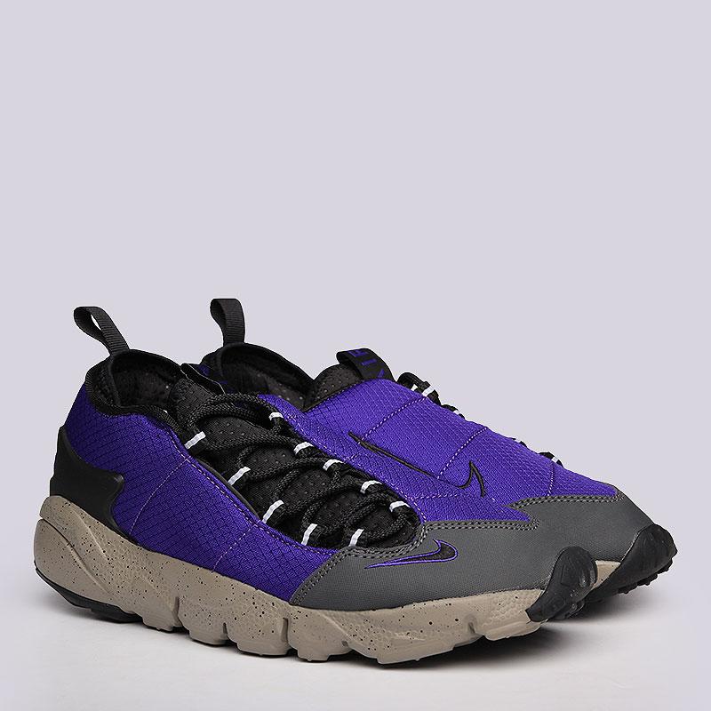 Кроссовки Nike Sportswear Air Footscape NMКроссовки lifestyle<br>Текстиль, синтетика, резина<br><br>Цвет: Синий, черный, серый<br>Размеры US: 11<br>Пол: Мужской