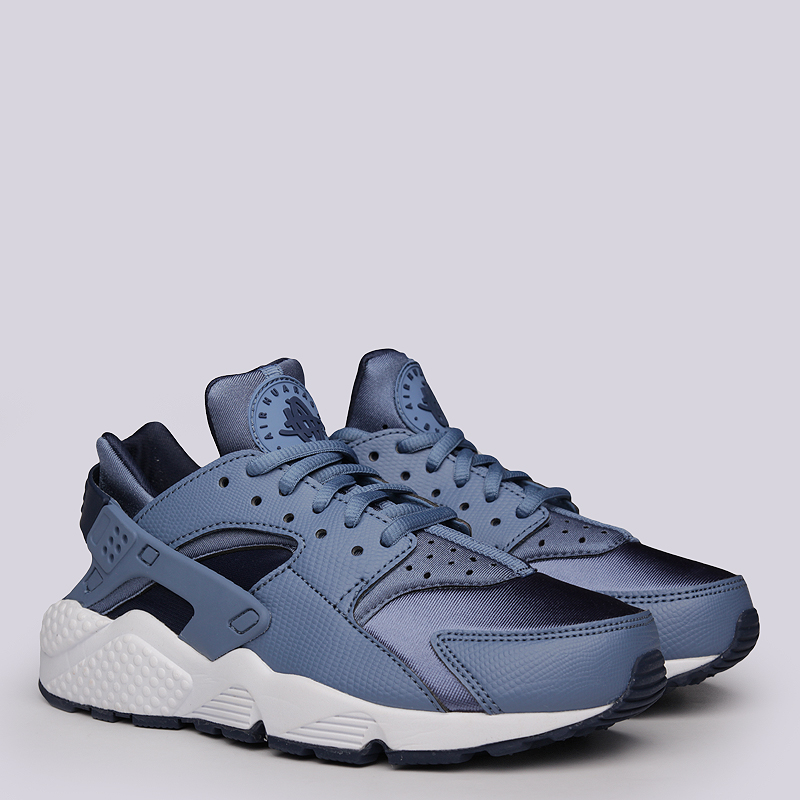 Кроссовки Nike Sportswear WMNS Air Huarache RunКроссовки lifestyle<br>Текстиль, синтетика, резина<br><br>Цвет: Синий<br>Размеры US: 6;7;8<br>Пол: Женский