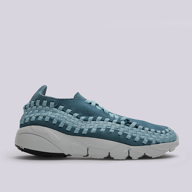 Кроссовки Nike Air Footscape Woven NMКроссовки lifestyle<br>кожа, текстиль, резина<br><br>Цвет: Голубой<br>Размеры US: 6.5;7;7.5;8;8.5;9;9.5;10;10.5;11.5<br>Пол: Мужской