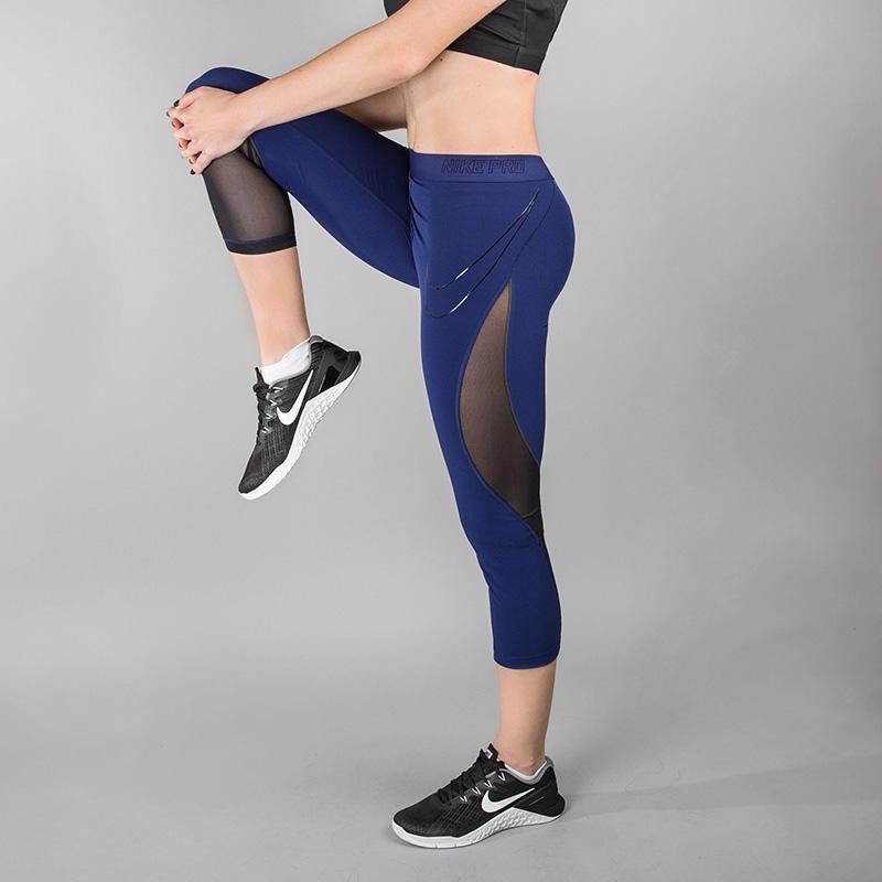 Капри для тренинга Nike NP HPRCL CPRI WovenБрюки и джинсы<br>84% полиэстер, 16% эластан<br><br>Цвет: Синий<br>Размеры US: XS;S;M;L<br>Пол: Женский