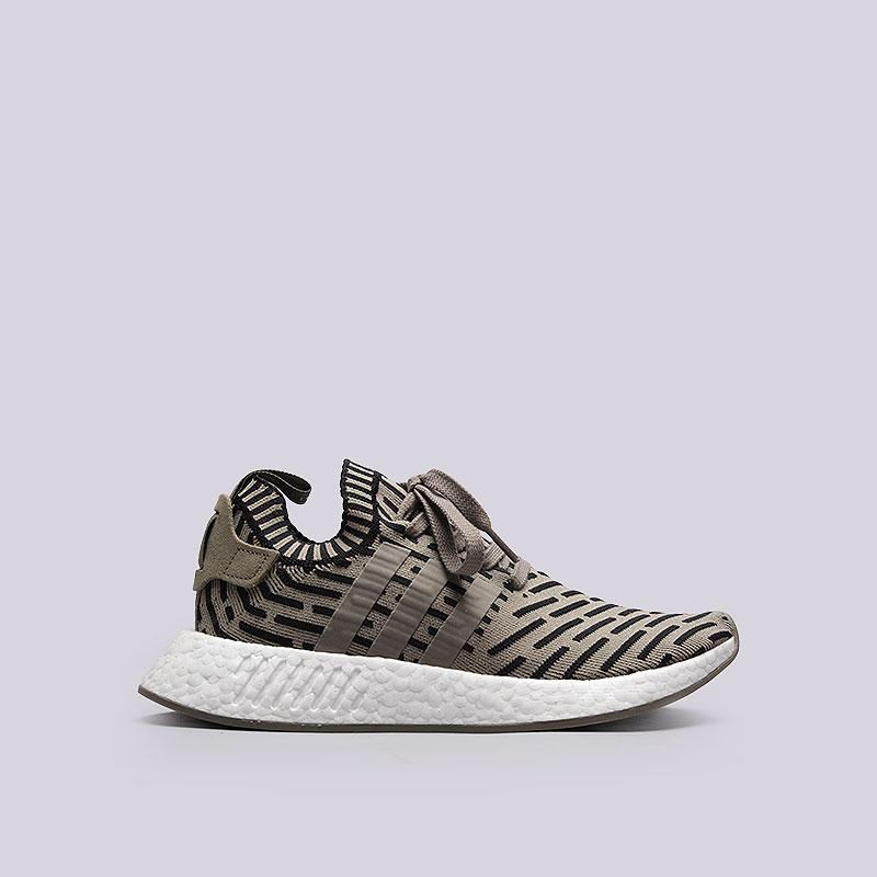 Кроссовки  adidas NMD_R2 PKКроссовки lifestyle<br>Кожа, текстиль, резина<br><br>Цвет: Бежевый<br>Размеры UK: 7<br>Пол: Мужской