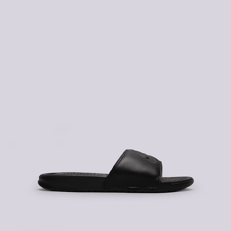 Сланцы Nike WMNS BenassiСланцы, балетки<br>Кожа, резина<br><br>Цвет: Чёрный<br>Размеры US: 5;6;11<br>Пол: Женский