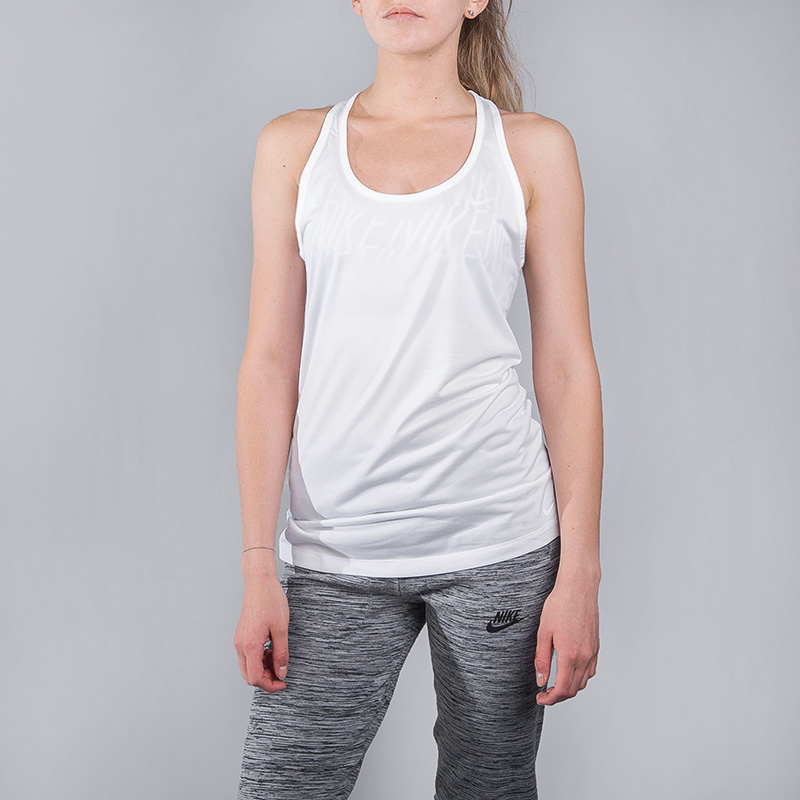 Топ Nike W NK DRY TANK BALANCEФутболки<br>Полиэстер<br><br>Цвет: Белый<br>Размеры US: S;M;L<br>Пол: Женский
