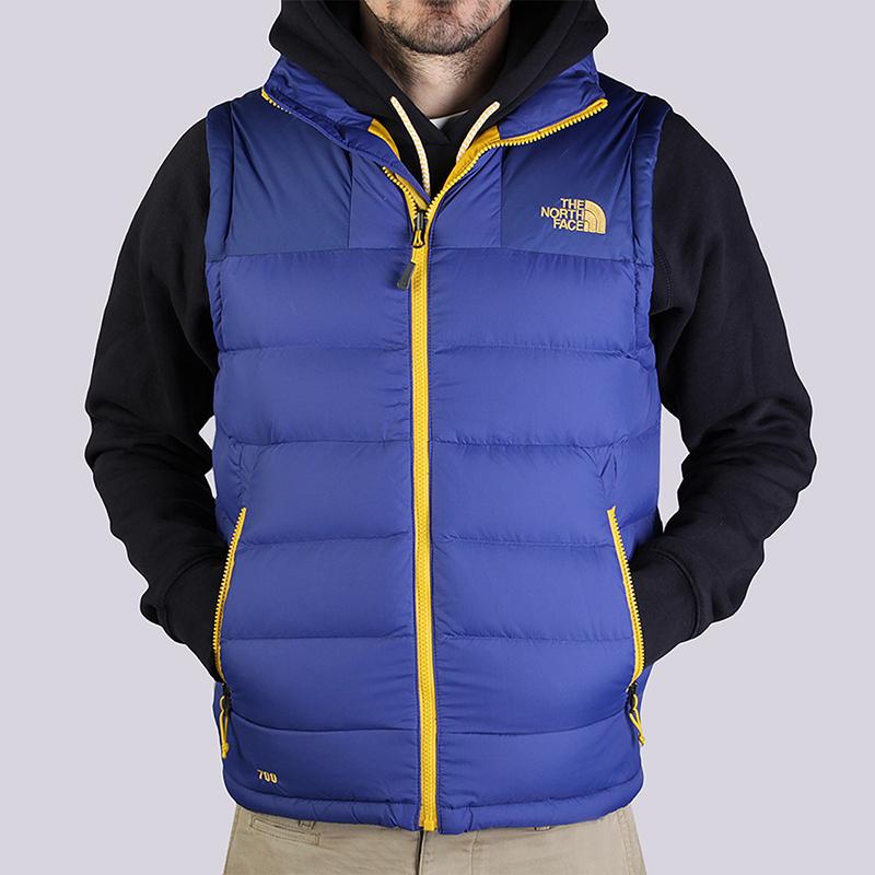 Жилет The North Face Massif VestКуртки, пуховики<br>Нейлон, гусиный пух<br><br>Цвет: Синий, желтый<br>Размеры US: S;XL<br>Пол: Мужской