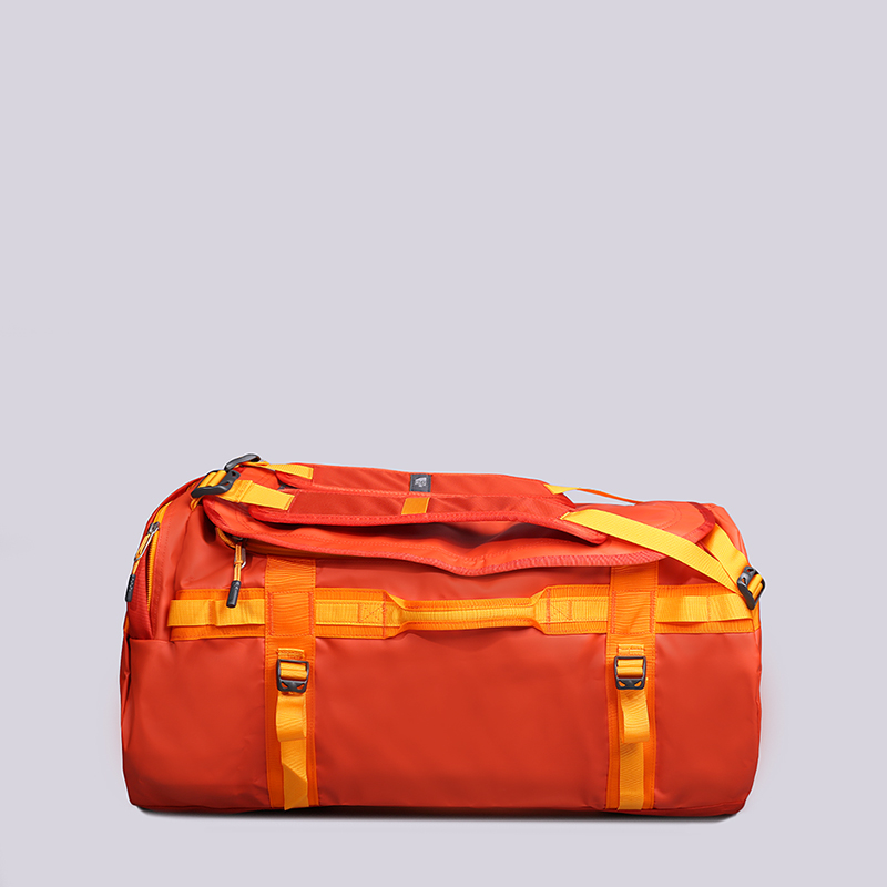 Сумка дорожная The North Face Base Camp Duffel - L 95LСумки, рюкзаки<br>Нейлон, полиэстер<br><br>Цвет: Оранжевый, желтый<br>Размеры US: OS