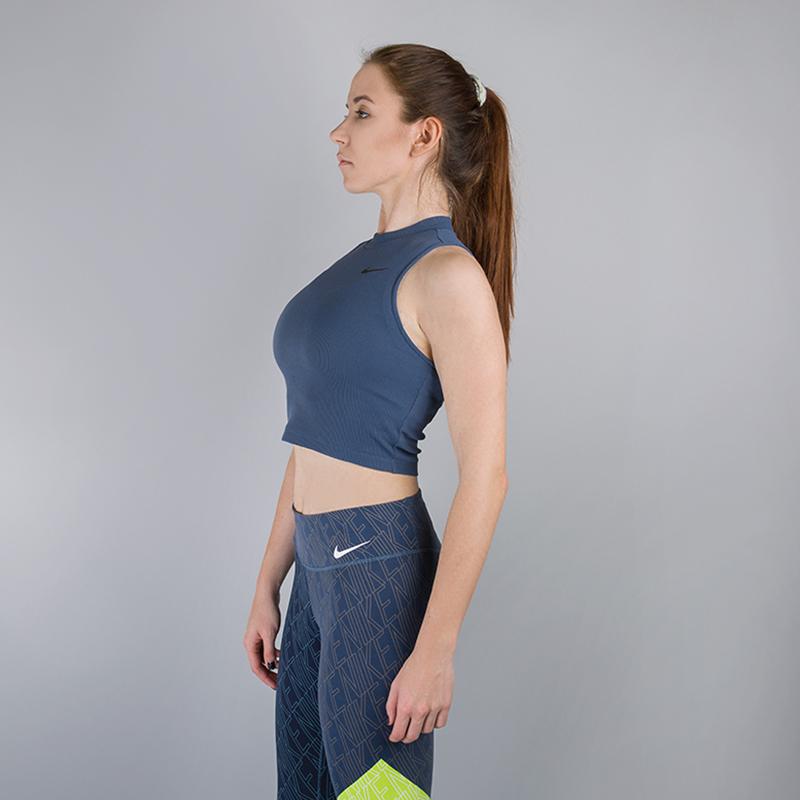 Топ Nike Dry CropБезрукавки<br>93% нейлон, 7% эластан<br><br>Цвет: Синий<br>Размеры US: S<br>Пол: Женский