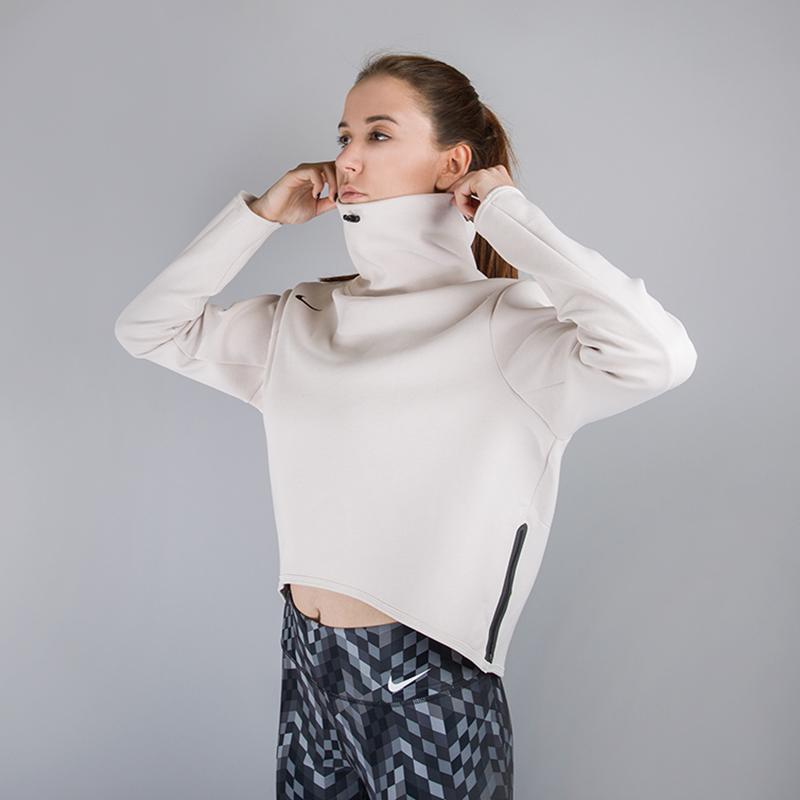 Толстовка Nike LGSL TopТолстовки свитера<br>85% полиэстер, 12% хлопок, 3% эластан<br><br>Цвет: Бежевый<br>Размеры US: S;M;L<br>Пол: Женский