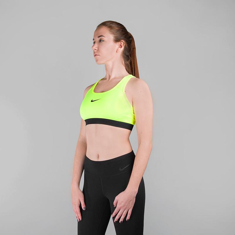 Топ Nike NP Classic BraБелье<br>Эластан, нейлон, полиэстер<br><br>Цвет: Неоновый желтый<br>Размеры US: XS;S;M;L<br>Пол: Женский