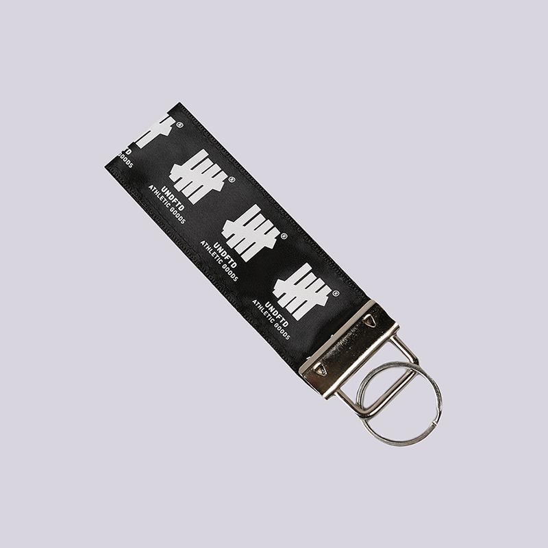 Брелок Undftd Loop KeychainБрелки<br>Текстиль, металл<br><br>Цвет: Черный<br>Размеры US: OS