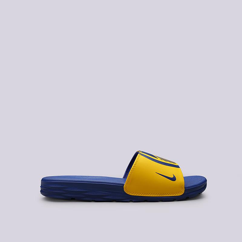 Сланцы Nike Benassi Solarsoft NBAСланцы, балетки<br>Синтетика, текстиль, пластик<br><br>Цвет: Синий, желтый<br>Размеры US: 5;6;7;8;9;10;11;12;13;14;15;16