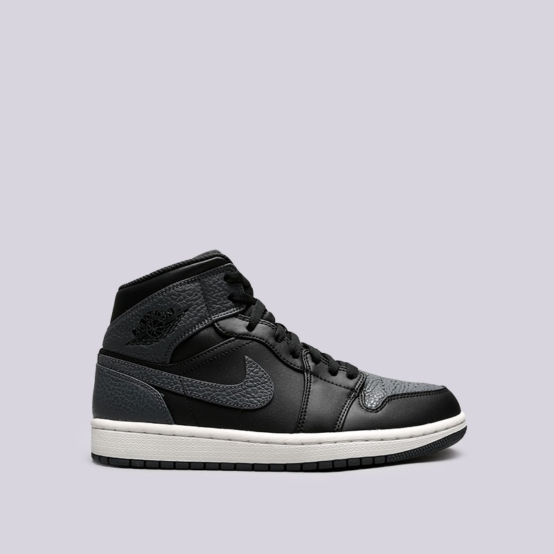 Кроссовки Jordan 1 MidКроссовки lifestyle<br>Кожа, синтетика, текстиль, резина<br><br>Цвет: Черный, серый<br>Размеры US: 8;8.5;10.5;11.5;12.5<br>Пол: Мужской