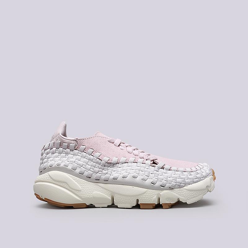 Кроссовки Nike WMNS Air Footscape WovenКроссовки lifestyle<br>Кожа, синтетика, текстиль, резина, пластик<br><br>Цвет: Розовый<br>Размеры US: 6;7;7.5;8;8.5<br>Пол: Женский
