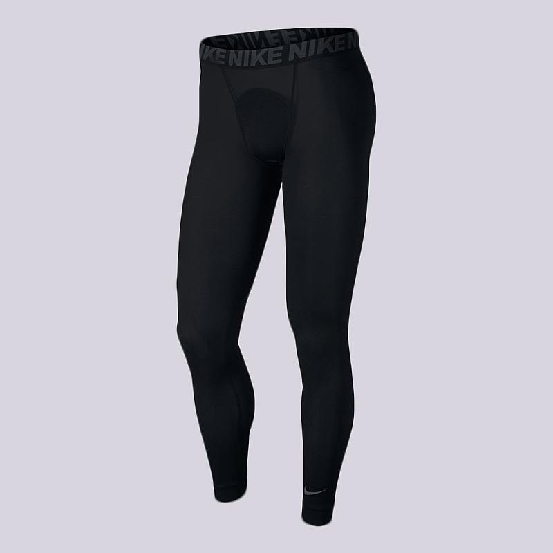 Тайтсы Nike Training Utility TightsКомпрессионное белье<br>94% полиэстер, 6% эластан<br><br>Цвет: Черный<br>Размеры US: S;M;L;XL<br>Пол: Мужской