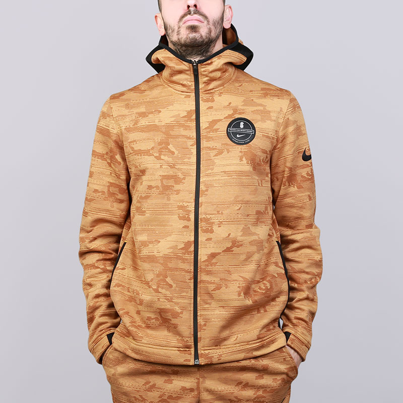 Толстовка Nike Dry Showtime Kyrie Printed Basketball HoodieТолстовки свитера<br>Полиэстер, хлопок<br><br>Цвет: Коричневый<br>Размеры US: S;M;L;XL;2XL<br>Пол: Мужской