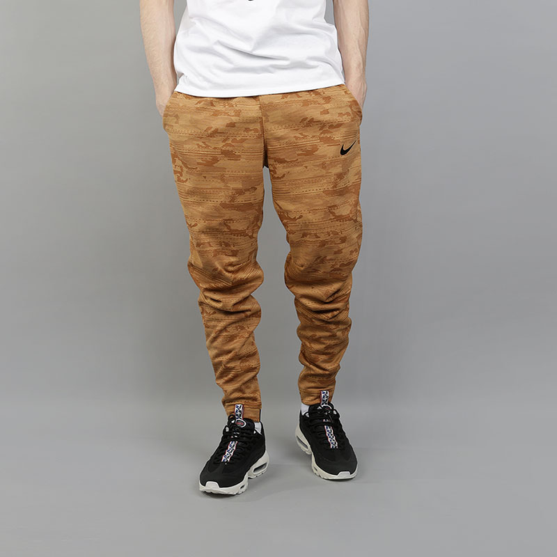 Брюки Nike Dri-FIT Kyrie Printed Basketball TrousersБрюки и джинсы<br>100% полиэстер<br><br>Цвет: Коричневый<br>Размеры US: S<br>Пол: Мужской