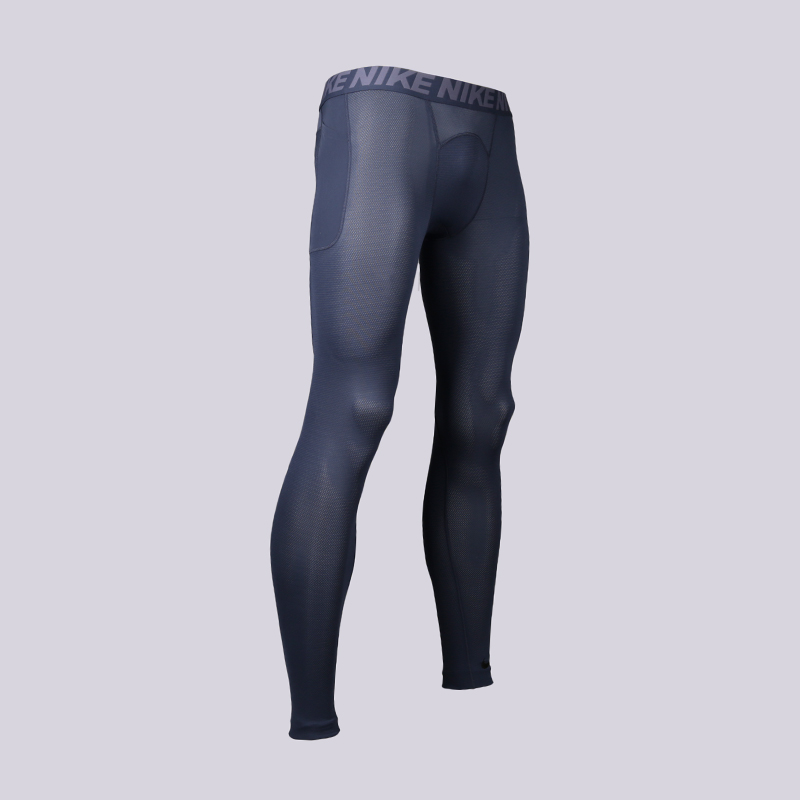 Тайтсы Nike Training UtilityКомпрессионное белье<br>Полиэстер, эластан<br><br>Цвет: Синий<br>Размеры US: S;M;L;XL;2XL<br>Пол: Мужской