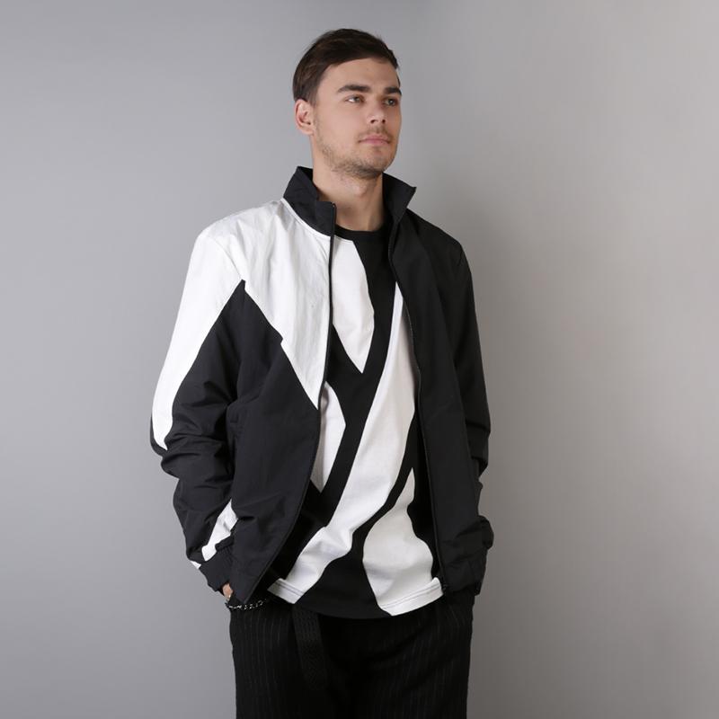 мужскую чёрную  куртку reebok lf tracktop DJ1950 - цена, описание, фото 2