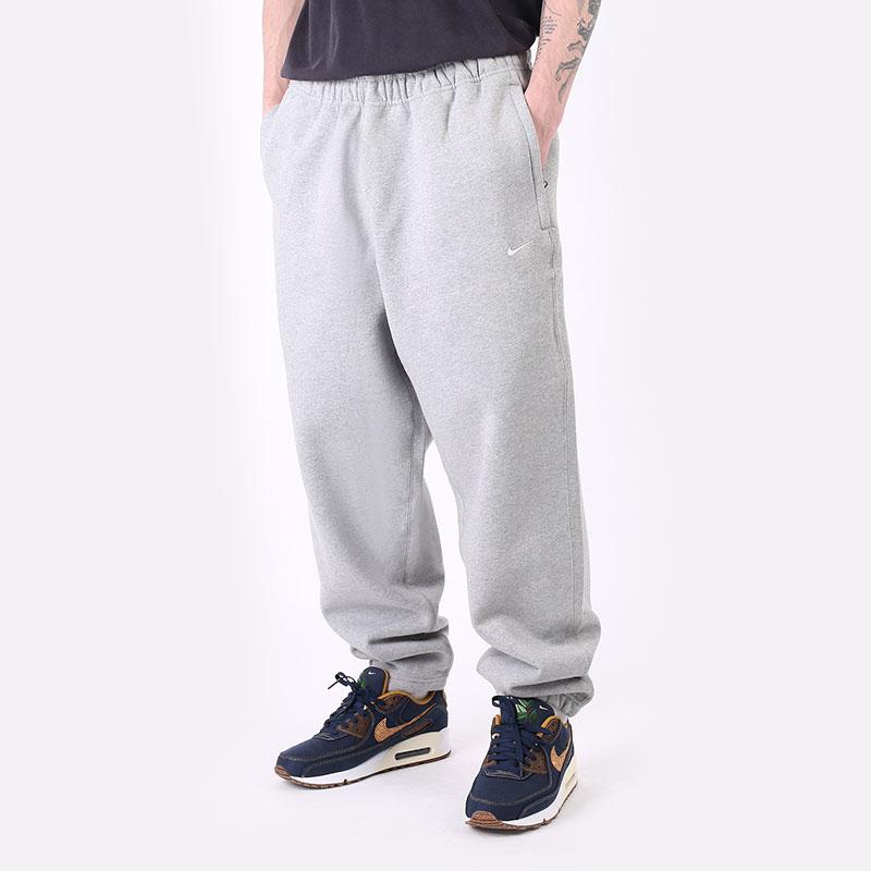 мужские серые  брюки nike nrg solo swoosh fleece pant CW5460-063 - цена, описание, фото 1