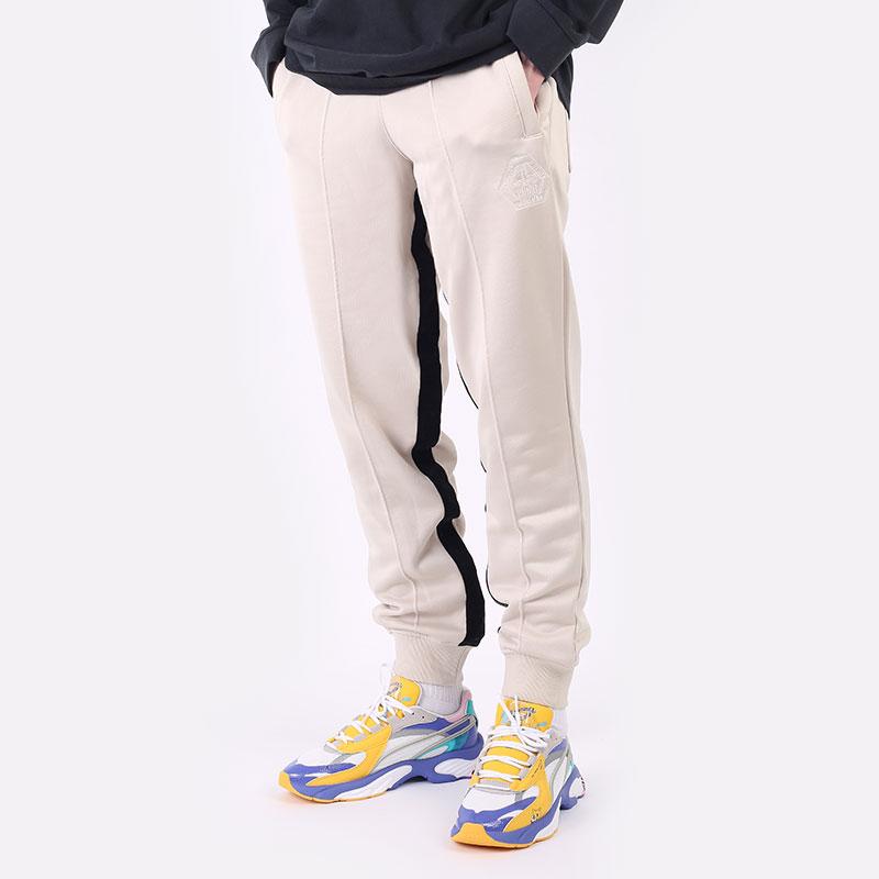 мужские бежевые  брюки puma rhuigi track pant 53257701 - цена, описание, фото 1