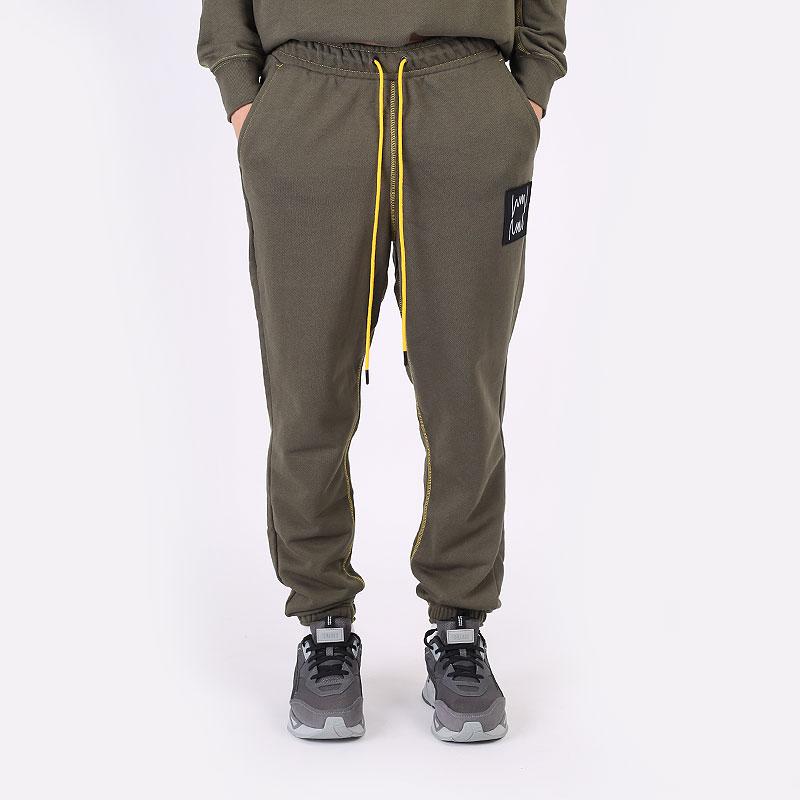мужские зеленые  брюки puma pivot pant 53211001 - цена, описание, фото 3