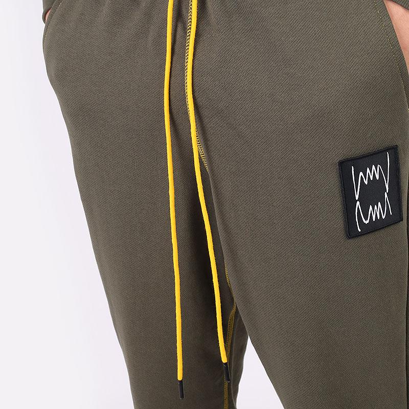 мужские зеленые  брюки puma pivot pant 53211001 - цена, описание, фото 2