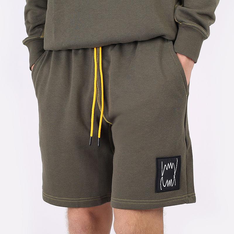 мужские зеленые шорты  PUMA Pivot Short 53210901 - цена, описание, фото 1