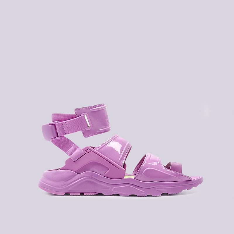 Сандали Nike WMNS Air Huarache Gladiator QSСланцы, балетки<br>Cинтетика, текстиль, резина<br><br>Цвет: Фиолетовый<br>Размеры US: 8;9<br>Пол: Женский